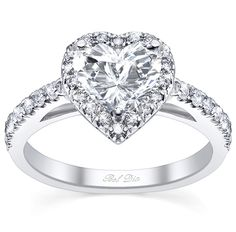 There is nothing more romantic than proposing with a heart-shaped diamond engagement ring. <3