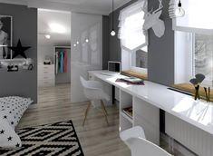 Solidne, szerokie, białe biurko na całą szerokość ściany pod oknem jest na pewno niezwykle wygodne w użytkowaniu. Ciemnoszare ściany tworzą tutaj tło dla białych mebli i dekoracji.