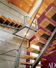 "An open staircase that has ""treads on a single, brushed-steel stringer,"" House Staircase, Entry Stairs, Open Staircase, Staircase Design, Glass Stairs, Concrete Stairs, Interior Stair Railing, Steel Stairs, Barn Renovation"