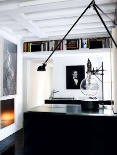 Masculine office with prints from famous inventors on the wall or family portraits? Copy of his grandfathers book and other family momentos in glass jars?