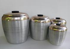 Vintage Aluminum Cannister Set, Brush Aluminum Cannisters, Deco Font. $26.00, via Etsy.