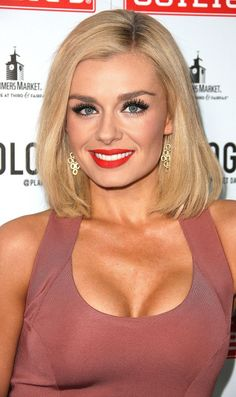 Here are 10 pics of KATHERINE JENKINS at Planet Dailies and Mixology 101 Grand Opening in Los Angeles. She is wearing a plunging pencil muted pink dress with gold clutch, sky-high platforms and popping red lipstick.