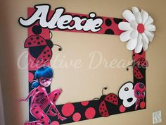 30 x 30x Black and red miraculous lady bug themed photo frame. Assembly required all the images would be adhere and the only thing to assemble is the frame. Very easy! each adhesive square needs to be adhere to the corners of the frame, if you need help please contact me. :)