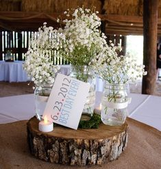 mason jar centerpieces | Our centerpieceswere made from burlap squares, mason jars with ribbon …