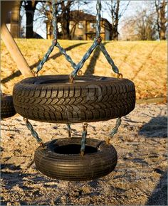 tire art on the playground | Picture of A childs swing on a playground