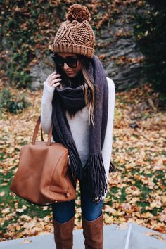 Knitted pom pom toque/hat, large brown leather bag, over the knee boots, scarf, sweater