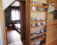 薪ストーブを囲む男前インテリアLOAFER Bookcase, Divider, Entryway, Shelves, Room, Furniture, Home Decor, Entrance, Bedroom