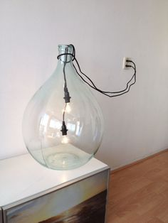 Large vase used as lamp #beautiful #creative Large vase is seconhand and for sale at www.pinkpoppy.nl