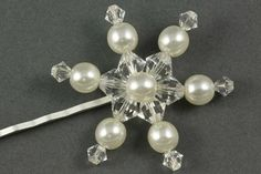 The Vintage Snowflake hair grip is perfect for a midwinter wedding, made with a mixture swarovski bicone crystals and pearls of various sizes.