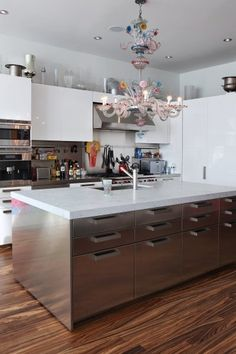 even-their-chandelier-and-cooking-space-echoes-the-novogratzes-colorful-aesthetic