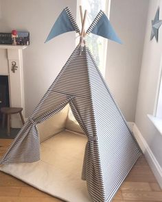 Teepee Tent for child in colourful ticking stripe. This indoor play tent can be made in 3 different colours and can be ordered with matching playmats and personalised name flags.