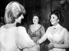 Elizabeth Taylor greets Diana, Princess of Wales, backstage at the Victoria Palace Theatre after a charity premiere of the play The Little Foxes in London.1982