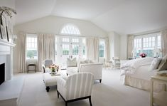 I love all white rooms, especially with windows like this. However, it's probably the least practical thing ever.