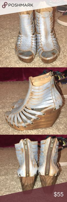 light blue metallic leather wedge w wooden heel never worn size 7 light blue metallic leather wedge with a wooden heel and flat bronze metal studs that connect the leather to the heal. comfortable to walk in with a zipper back Bed Stu Shoes Wedges