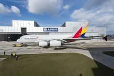 First A380 for Asiana Airlines shines in full livery as it's rolled out of the Airbus factory in Hamburg, Germany in March of 2014.