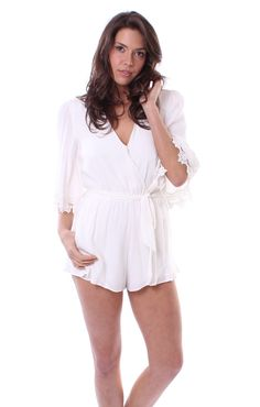Reese Romper -Never has a romper looked so chic and classy. The Reese Romper by Lovers + Friends has a cinched waist, three-quarter sleeves with lace detailed sleeves, a V-neckline and flouncy shorts. In a classic shade of ivory and fully lined, this romper is ultra comfortable as well as becomingly elegant.