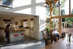 View from a double height oak framed extension into a single height kitchen.