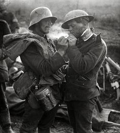 WWI. German and British soldiers share cigarette during Christmas 1914 truce of The Great War