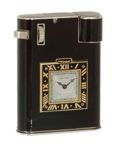 Cartier Art Deco 18K and silver European watch lighter.