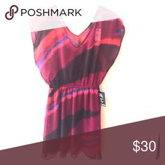 Express Dress NWT Top is sheer with beautiful colors. Has a brown slip dress underneath. Never been worn, still has tag. Express Dresses