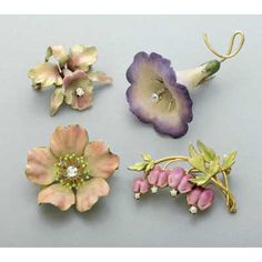 ART NOUVEAU ENAMELED GOLD AND DIAMOND FLOWER BROOCHES, ca. 1910. 14k yg…