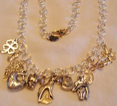 """All Silver Chainlink Necklace w/ Charms: 19"""" long what a beauty! The chain is all in silver tone with lots of charms like a hand, horse, heart, kitty, purse, cowboy boot, owl, clover,bike, etc etc. Free shipping in USA..."""