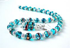 Turquoise blue and silver beaded necklace by sparklecityjewelry, $36.00
