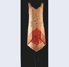 Evening dress, Callot Soeurs, 1925.Salmon pink silk rep, embroidered with stylized Chinese floral motifs in orange silk and gold [something].