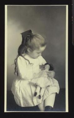 Young Girl Holds Doll in Her Lap Photograph Snapshot Circa 1910'S | eBay