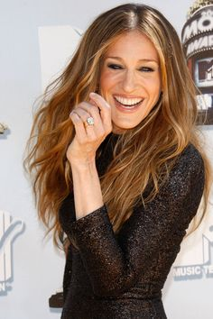 Matthew Broderick gave SJP her stunning emerald-cut ring before the couple's 1997 marriage.   - HarpersBAZAAR.com