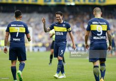 Dario Benedetto of Boca Juniors celebrates with teammates Fernando Gago and Cristian Pavon after scoring the first goal of his team during a match between Boca Juniors and Union as part of Torneo Primera Division 2016/17 at Alberto J. Armando Stadium on June 25, 2017 in Buenos Aires, Argentina.