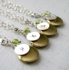 Bridesmaid locket bracelets are a cute gift idea.  Make it even more personal with an initial charm and birthstone gem. | Handmade Wedding Charms via http://emmalinebride.com/decor/handmade-wedding-charms/