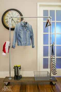 DIY galvanized pipe and wood mobile coat rack on casters @diyshowoff
