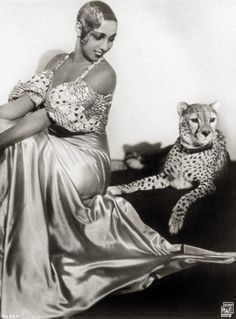 "Josephine Baker (1906-1975)  ""Black Pearl"" Jospehine Baker was everyone's favorite Americaine in Paris. The comic chorine with the dazzling smile, barely there costumes, and diamond-collared cheetah, Baker was the rage of the Folies Bergère. A civil rights activist, Baker insisted on integrated audiences, adopted a ""rainbow tribe"" of 12 children, and spoke alongside Martin Luther King, Jr. Photo:Transcendental Graphics / 2006 Mark Rucker"