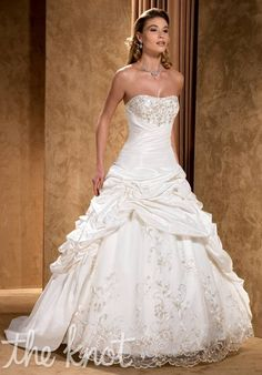 Gown features beading, embroidery, matching wrap,   and lace-up back.  This dress is so interesting to me!