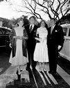 Van Johnson (left) escorts his wife Evie, in white dress, and Freddie Brisson. Rosalind Russell, wife of Freddie Brisson, is at left. They are arriving for the wedding of Elizabeth Taylor and Conrad (Nick) Hilton Jr., in Beverly Hills, California on May 6, 1950. (AP Photo)