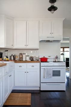 butcher block, subway tile and white cabinets...a true kitchen classic!!!