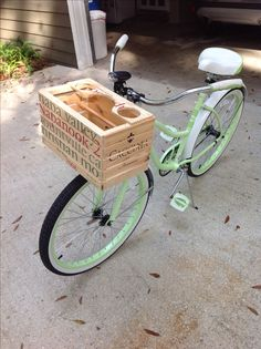 Bike basket I made for my wife's new bike. Made from two wooden wine crates. My wife saw one on a bike in Charleston and wanted one. Adapted the mounting bracket from the old wire basket that she did have. Even comes with drink holders.