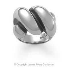 """The Sisterhood Ring is 1/2"""" wide and available in sizes 5 to 10. This twisted dome ring is named in honor of one of our dear customers who unfortunately lost her battle with a terminal illness. She began the tradition of giving this ring, which represents two parallel lives, to those women in her life that shared a special bond of friendship, hence the name, """"The Sisterhood Ring"""". Her friends have continued the tradition of gifting this ring to others, as a tribute to this remarkable woman…"""