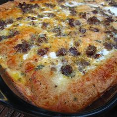 """Christmas Breakfast Pizza   """"Sausage, eggs, crescent rolls, and cheese snuggle down in a casserole, chill overnight, and bake in the morning. It's a great dish for a holiday brunch."""""""