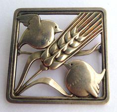 Birds on a Wheat Sheaf, a silver brooch by Georg Jensen, ca.1945