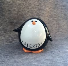 PENGUIN PIGGY BANK -Ceramic Piggybank Personalized Baby Gift Penguin Piggy Bank Ceramic Bank Custom Hand Painted New Baby Present by APrettyPenny3 on Etsy https://www.etsy.com/listing/223305472/penguin-piggy-bank-ceramic-piggybank