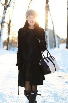 Dress by Laundry by Shelli Segal, jacket and bag by J.Crew, boots by Hunter, tights by Milly, hat by Kate Spade, gloves by Ralph Lauren. (February 11, 2013)