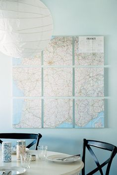 Take a map or blown-up photo and segregate it over several canvases. When hung in a group, they reveal the larger image
