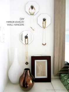 I love these! And actually, I wouldn't mind having a few of those mirrors just plain - cute, cute, cute! // DIY Mirror Jewelry Wall Hangers // Homey Oh My!