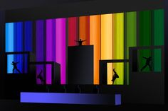 Cool rainbow light up backdrop with dancing silhouettes.