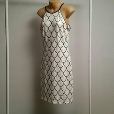 Cache' Black and White Sequence Dress size 10 Very cute dress! Zips down the back. Never Worn! Size 10 but runs small. It measures 32.5 inches in length. Cache Dresses Midi