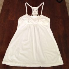 Aerie Racerback Tank Super cute , loose fitting, aerie racerback tank with little silver stones and lace detail on the back. Good condition!!! aerie Tops Tank Tops