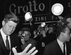 """President John F. Kennedy, left, is the subject of cameras as he arrives on January 19, 1962 at New York?s 46th Street Theatre to attend a performance of the Broadway play, """"How to Succeed in Business Without Really Trying."""" (AP Photo)"""