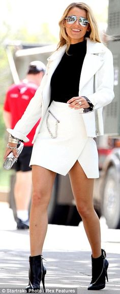 Retro rules: Blake looked incredible in a white blazer and split skirt with black top and boots and mirrored aviator sunglasses